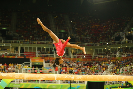 olympic ring: RIO DE JANEIRO, BRAZIL AUGUST 15, 2016: Olympic champion Simone Biles of United States competes at the final on the balance beam women`s artistic gymnastics at Rio 2016 Olympic Games