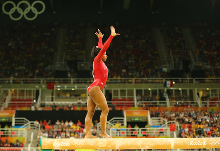 RIO DE JANEIRO, BRAZIL AUGUST 15, 2016: Olympic champion Simone Biles of United States competes at the final on the balance beam women`s artistic gymnastics at Rio 2016 Olympic Games