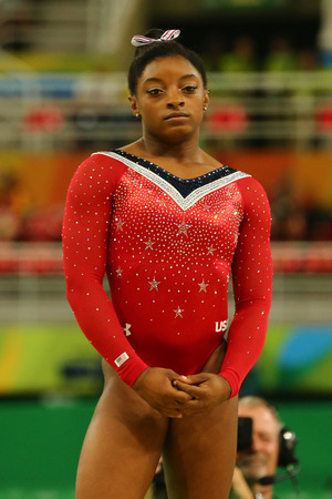 RIO DE JANEIRO, BRAZIL - AUGUST 15, 2016: Olympic champion Simone Biles of United States before final competition on the balance beam womens artistic gymnastics at Rio 2016 Olympic Games