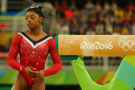 olympic ring: RIO DE JANEIRO, BRAZIL - AUGUST 15, 2016: Olympic champion Simone Biles of United States before final competition on the balance beam womens artistic gymnastics at Rio 2016 Olympic Games