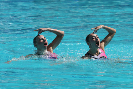 piscina olimpica: RIO DE JANEIRO, BRAZIL - AUGUST 14, 2016: Lolita Ananasova and Anna Voloshyna of Ukraine compete during synchronized swimming duets free routine preliminary of the Rio 2016 Olympic Games Editorial