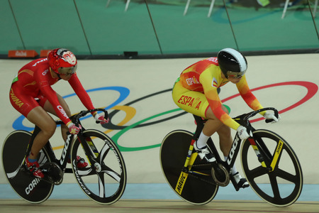 keirin: RIO DE JANEIRO, BRAZIL - AUGUST 13, 2016: Cyclists in action during Rio 2016 Olympics womens keirin first round heat 2 at the Rio Olympic Velodrome in the Barra Olympic Park in Rio de Janeiro