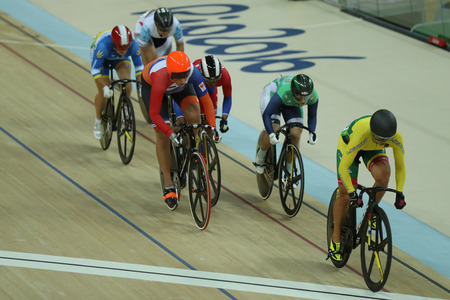 RIO DE JANEIRO, BRAZIL - AUGUST 13, 2016: Cyclists in action during Rio 2016 Olympics womens keirin first round heat 4 at the Rio Olympic Velodrome in the Barra Olympic Park in Rio de Janeiro Editorial