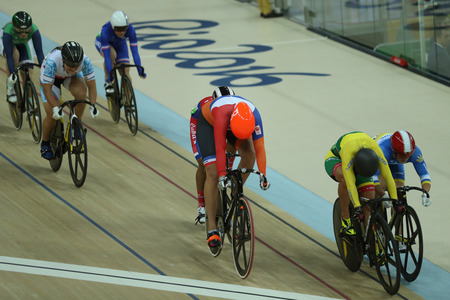 RIO DE JANEIRO, BRAZIL - AUGUST 13, 2016: Olympic Champion Elis Ligtlee of Netherlands (middle) in action during Rio 2016 Olympics womens keirin first round heat 4 at the Rio Olympic Velodrome