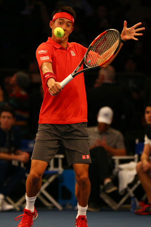NEW YORK - MARCH 6, 2017: Professional tennis player Kei Nishikori of Japan in action during  BNP Paribas Showdown 10th Anniversary tennis event at Madison Square Garden in New York
