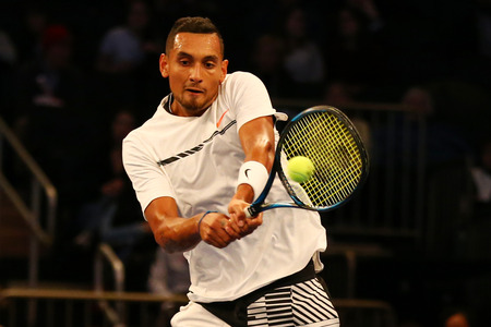 nick: NEW YORK - MARCH 6, 2017: Professional tennis player Nick Kyrgios of Australia in action during  BNP Paribas Showdown 10th Anniversary tennis event at Madison Square Garden in New York