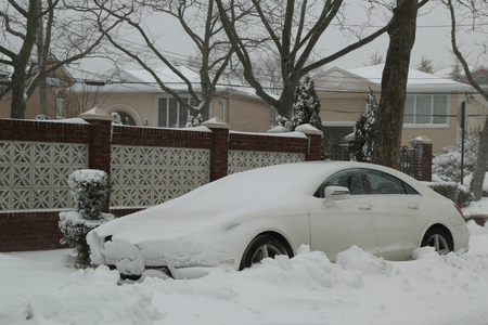 inconvenient: Car under snow in Brooklyn, NY after massive Winter Storm Niko strikes Northeast. Stock Photo