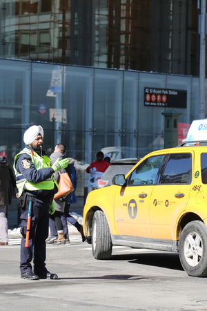 NEW YORK - MARCH 16, 2017: NYPD Traffic officer wears turban with insignia attached in Manhattan