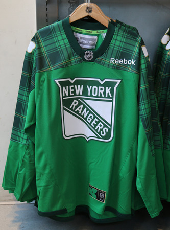 NEW YORK - MARCH 16, 2017: New York Rangers St. Patrics Day special edition jersey on display at NHL store in Midtown Manhattan. Editorial