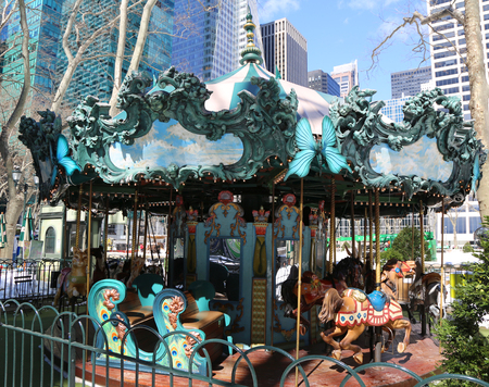 NEW YORK - MARCH 16, 2017:  Le Carrousel in Bryant Park, Midtown Manhattan. Le Carrousel in Bryant Park, specially created to complement the parks French classical style