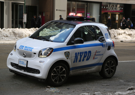 new world order: NEW YORK - MARCH 16, 2017: NYPD smallest car Smart ForTwo in Midtown Manhattan. Editorial