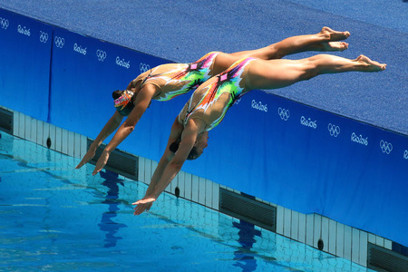 preliminary: RIO DE JANEIRO, BRAZIL - AUGUST 15, 2016: Iryna Limanouskaya and Veronika Yesipovich of team Belarus compete during synchronized swimming duets free routine preliminary of the Rio 2016 Olympic Games