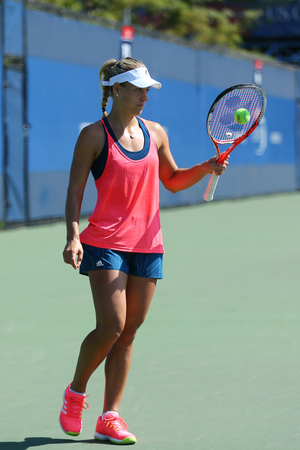 forehand: NEW YORK - AUGUST 27, 2016: Grand Slam champion Angelique Kerber of Germany  practices for US Open 2016 at Billie Jean King National Tennis Center in New York Editorial