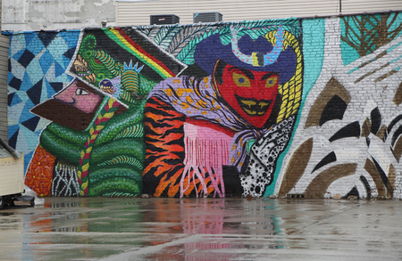 NEW YORK - MARCH 7, 2017: Mural art at East Williamsburg in Brooklyn. Outdoor art gallery known as the Bushwick Collective has most diverse collection of street art in Brooklyn