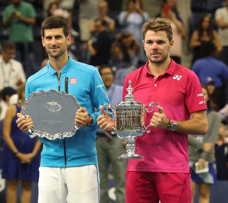 NEW YORK - SEPTEMBER 11, 2016: Runner-up Novak Djokovic of Serbia (L) and US Open 2016 champion Stanislas Wawrinka of Switzerland during trophy presentation after US Open 2016 mens final match Editorial