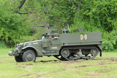 wehrmacht: OLD BETHPAGE , NEW YORK - MAY 22, 2016: The M3A1 Scout Car from the Museum of American Armor during World War II Encampment in Bethpage, NY