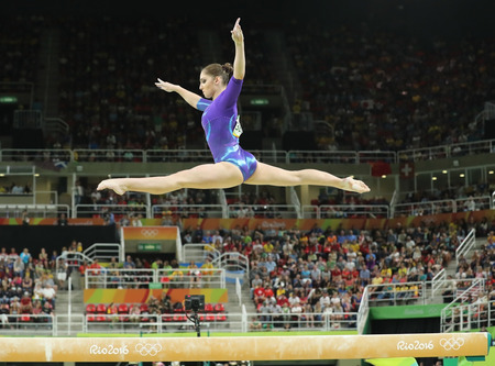 olympic symbol: RIO DE JANEIRO, BRAZIL - AUGUST 11, 2016: Artistic gymnast Aliya Mustafina of Russian Federation competes on the balance beam at womens all-around gymnastics at Rio 2016 Olympic Games