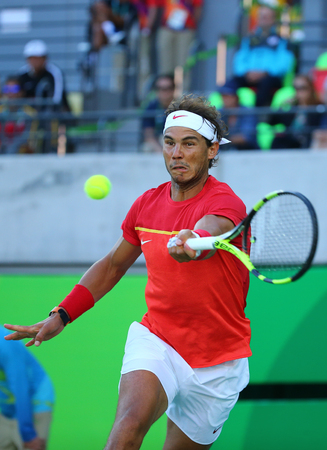 RIO DE JANEIRO, BRAZIL - AUGUST 13, 2016: Olympic champion Rafael Nadal of Spain in action during mens singles semifinal match of the Rio 2016 Olympic Games at the Olympic Tennis Centre