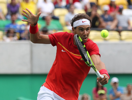atp: RIO DE JANEIRO, BRAZIL - AUGUST 11, 2016: Olympic champion Rafael Nadal of Spain in action during mens singles round four match of the Rio 2016 Olympic Games at the Olympic Tennis Centre Editorial
