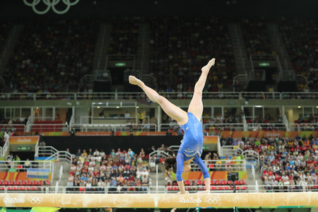 olympic symbol: RIO DE JANEIRO, BRAZIL - AUGUST 11, 2016: Artistic gymnast Seda Tutkhalyan of Russian Federation competes on the balance beam at womens all-around gymnastics at Rio 2016 Olympic Games Editorial