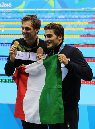 RIO DE JANEIRO, BRAZIL - AUGUST 13, 2016: Olympic champion Gregorio Paltrinieri (L)  and Gabriele Detti of Italy during medal presentation at the mens 1500 metre freestyle of  Rio 2016 Olympic Games