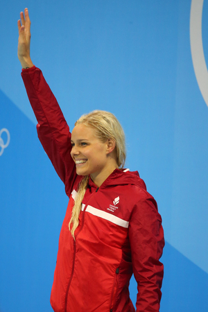 RIO DE JANEIRO, BRAZIL - AUGUST 13, 2016: Olympic champion Pernille Blume of Denmark celebrates victory during medal ceremony after Womens 50 metre freestyle final of the Rio 2016 Olympic Games