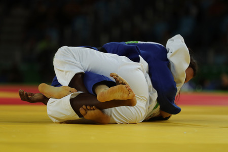 Judoka fighters during fight in judo competitions