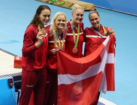 summer olympics: RIO DE JANEIRO, BRAZIL - AUGUST 13, 2016: Bronze medalists Team Denmark Womens 4 × 100m medley relay Mie Nielsen, Rikke Moller Pedersen, Jeanette Ottesen, Pernille Blume at the Rio 2016 Olympics Editorial