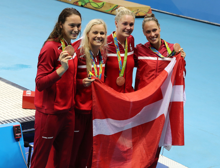 RIO DE JANEIRO, BRAZIL - AUGUST 13, 2016: Bronze medalists Team Denmark Womens 4 × 100m medley relay Mie Nielsen, Rikke Moller Pedersen, Jeanette Ottesen, Pernille Blume at the Rio 2016 Olympics Editorial