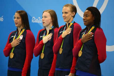 summer olympics: RIO DE JANEIRO, BRAZIL - AUGUST 13, 2016:Champions team USA Womens 4 � 100m medley relay Kathleen Baker (L) Lilly King, Dana Vollmer and Simone Manuel celebrate victory at the Rio 2016 Olympic Games Editorial