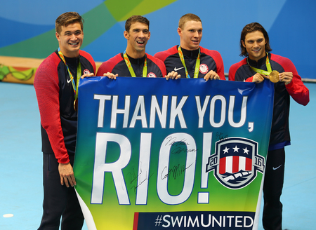 medley: RIO DE JANEIRO, BRAZIL - AUGUST 13, 2016: USA Mens 4x100m medley relay team Nathan Adrian(L), Michael Phelps, Ryan Murphy and Cory Miller celebrate victory at the Rio 2016 Olympic Games