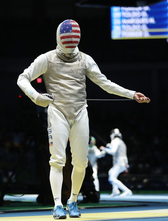 olympic symbol: RIO DE JANEIRO, BRAZIL - AUGUST 12, 2016: Fencer Alexander Massialas of United States competes in the Mens team foil of the Rio 2016 Olympic Games at the Carioca Arena 3 Editorial