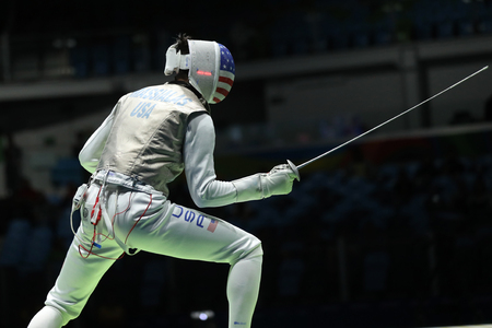 RIO DE JANEIRO, BRAZIL - AUGUST 12, 2016: Fencer Alexander Massialas of United States competes in the Mens team foil of the Rio 2016 Olympic Games at the Carioca Arena 3 Editorial