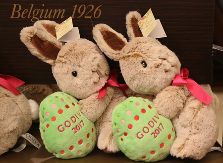NEW YORK - APRIL 4, 2017: Godiva Chocolatier 2017 Limited Edition Plush Bunny on display in Macys Herald Square. Godiva Chocolatier is a manufacturer of premium chocolates founded in Belgium in 1926.