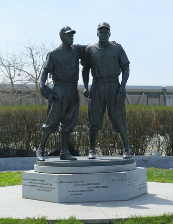 ballpark: BROOKLYN, NEW YORK - APRIL 13, 2017: Jackie Robinson and Pee Wee Reese Statue in front of MCU ballpark in Brooklyn