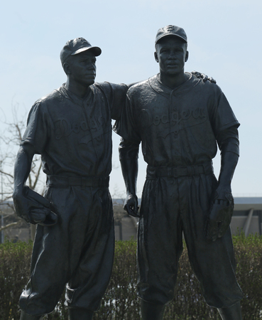 outfield: BROOKLYN, NEW YORK - APRIL 13, 2017: Jackie Robinson and Pee Wee Reese Statue in front of MCU ballpark in Brooklyn