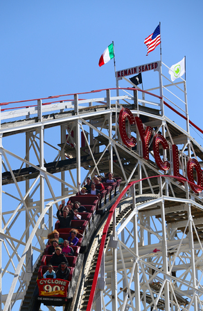 BROOKLYN, NEW YORK - APRIL 13, 2017: Historical landmark Cyclone roller coaster in the Coney Island section of Brooklyn. Cyclone is a historic wooden roller coaster opened on June 26, 1927 Editorial