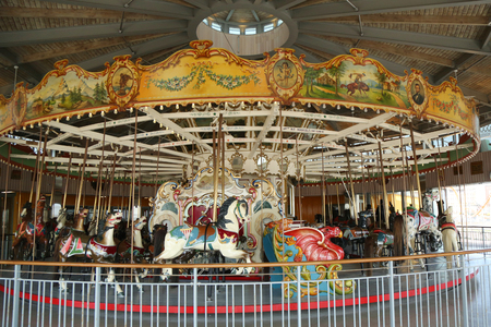 BROOKLYN, NEW YORK - APRIL 13, 2017: Horses on a traditional fairground B&B carousel at historic Coney Island Boardwalk in Brooklyn