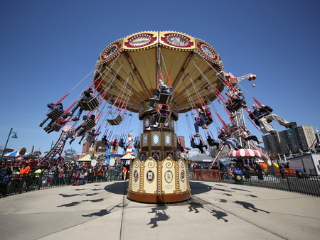 trapeze: BROOKLYN, NEW YORK - APRIL 13, 2017: Lynns Trapeze swing carousel in Coney Island Luna Park. Coney Island Luna Park was destroyed by fire in 1944, then reopened in 2010 Editorial