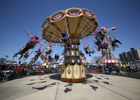 BROOKLYN, NEW YORK - APRIL 13, 2017: Lynns Trapeze swing carousel in Coney Island Luna Park. Coney Island Luna Park was destroyed by fire in 1944, then reopened in 2010 Editorial