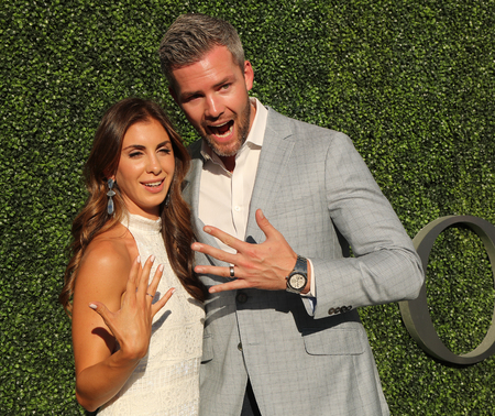 listing: NEW YORK - AUGUST 29, 2016: American real estate salesperson and reality television star Ryan Serhant (R) and Emilia Bechrakis attend US Open 2016 opening ceremony at USTA National Tennis Center