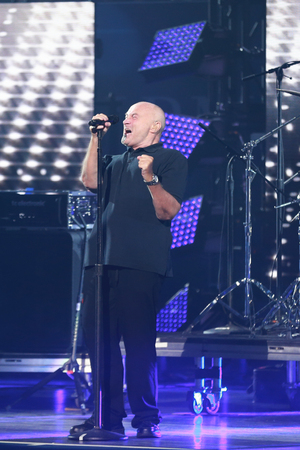 NEW YORK - AUGUST 29, 2016: Legendary singer Phil Collins opens the US Open 2016 performing his legendary hit In the Air Tonight at at USTA Billie Jean King National Tennis Center in New York