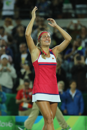 RIO DE JANEIRO, BRAZIL - AUGUST 13, 2016: Olympic champion Monica Puig of Puerto Rico celebrates victory after tennis womens singles final of the Rio 2016 Olympic Games at the Olympic Tennis Centre