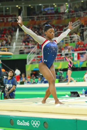 RIO DE JANEIRO, BRAZIL - AUGUST 11, 2016: Olympic champion Simone Biles of United States competing a vault at womens all-around gymnastics at Rio 2016 Olympic Games