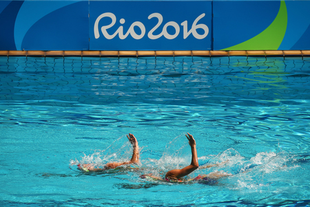 piscina olimpica: RIO DE JANEIRO, BRAZIL - AUGUST 15, 2016: Lolita Ananasova and Anna Voloshyna of Ukraine compete during synchronized swimming duets free routine preliminary of the Rio 2016 Olympic Games