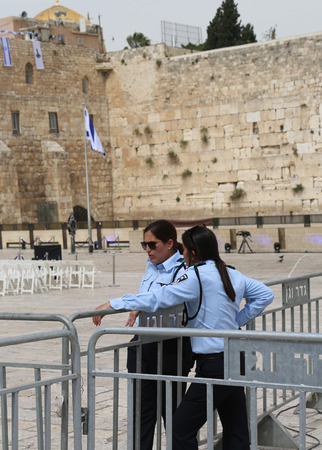 policewomen: JERUSALEM, ISRAEL - APRIL 30, 2017: Israeli Policewomen provide security next to the Western Wall in the Old City of Jerusalem. Editorial