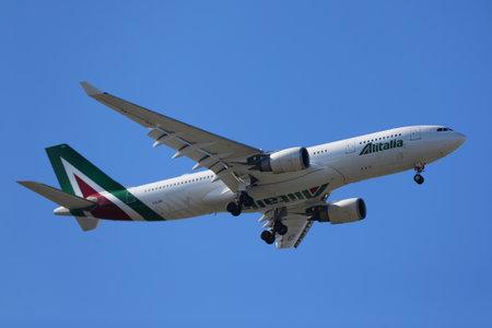 NEW YORK - APRIL 18, 2017: Alitalia Airbus A330 descends for landing at JFK International Airport in New York