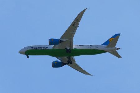 NEW YORK - MAY 20, 2017: Uzbekistan Airways Boeing 787 Dreamliner descends for landing at JFK International Airport in New York Editorial