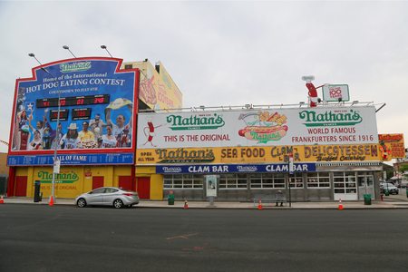 famous industries: BROOKLYN, NEW YORK - MAY 23, 2017: The Nathans original restaurant at Coney Island, New York. The original Nathans still exists on the same site that it did in 1916.
