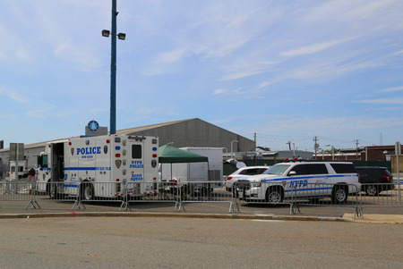 new world order: NEW YORK - MAY 28, 2017: NYPD bomb squad provides security at Brooklyn Cruise Terminal during Fleet Week 2017 in New York